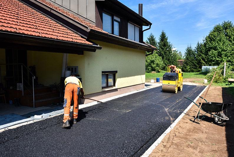 Укладка асфальта, асфальтирование, дорожные работы, строительство дорог